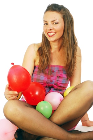 A young woman while playing with balloons