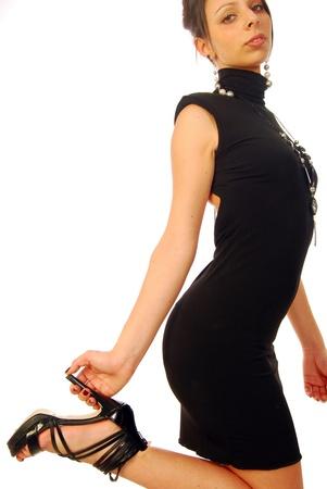 A pretty girl with dark hair in an elegant evening dress Stock Photo - 10816778