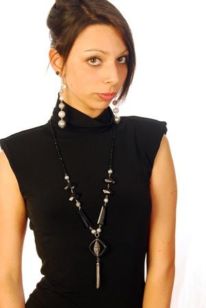 A pretty girl with dark hair in an elegant evening dress Stock Photo - 10816811