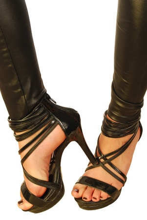 Detail of the feet of a girl with sexy high heels photo