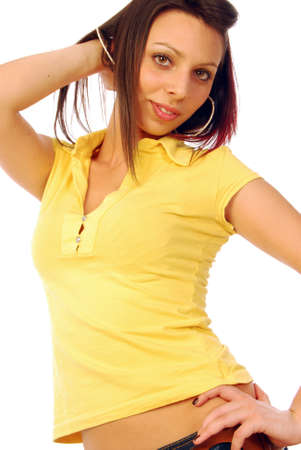 A beautiful and sexy brunette in a yellow T-shirt photo