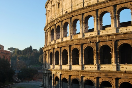 A striking image of the Coliseum of Rome at dawn photo