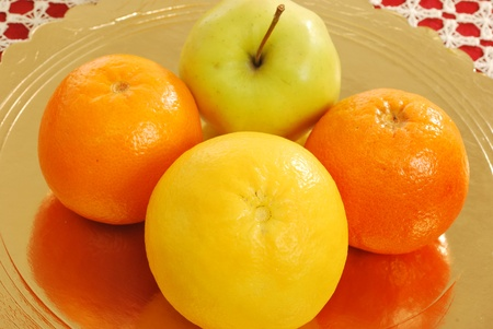 Mixed fruit 003 - A group of oranges, grapefruits, tangerines, apples and kiwi fruit for a healthy and nutritious breakfast photo
