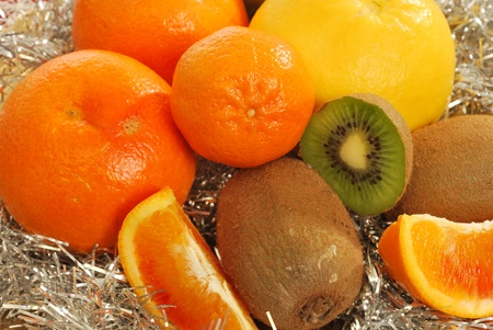 Mixed fruit 011 - A group of oranges, grapefruits, tangerines, apples and kiwi fruit for a healthy and nutritious breakfast photo