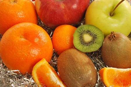 Mixed fruit 014 - A group of oranges, grapefruits, tangerines, apples and kiwi fruit for a healthy and nutritious breakfast photo