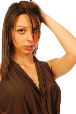 A brunette woman in elegant brown dress  Stock Photo - 13651065