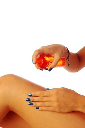 Sunscreen - A woman while spraying a sunscreen 347