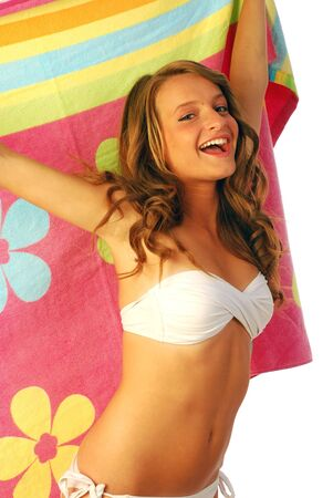 All at sea - A happy girl with the towel to the sea 007 Stock Photo