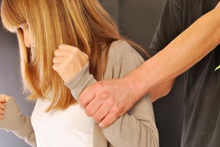 A woman who suffers violence