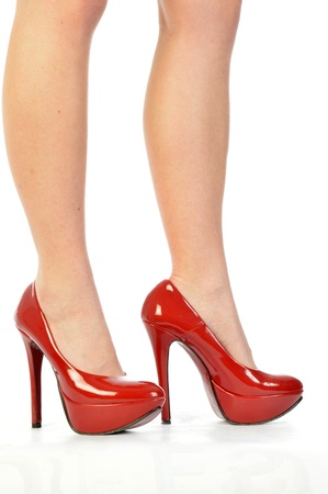 Red Shoes 158 - The legs and shoes of a seductive girl photo