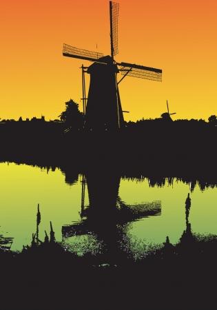 Windmill at sunset photo