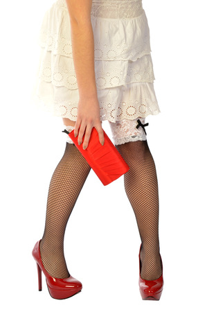 A woman in white dress and fishnet stockings photo