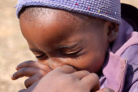 marginalization: Africa -Tanzania - Village Pomerini - august 2013 - The Franciscan Mission for Humanitarian Aid - The look on the faces of the children of Africa, many of them sick with AIDS, a look for the future Editorial