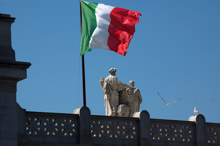 altar of fatherland: The Italian flag waving at the altar of the Fatherland in Roma-Italy