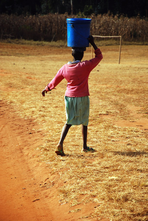 The water bearer - Pomerini - Tanzania - Africa