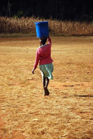 necessity: The water bearer - Pomerini - Tanzania - Africa