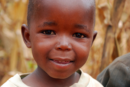 August 2014-Africa-Tanzania-African Children of the Village Pomerini hit by the AIDS virus. Between a present of misery, poverty and disease, and a future of hope contained in their eyes.