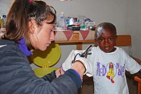 August 2014-Village of Pomerini-Tanzania-Africa-The intervention of medical first aid of volunteer nurses in the infirmary of the Franciscan Mission of the Village of Pomerini in Tanzania.