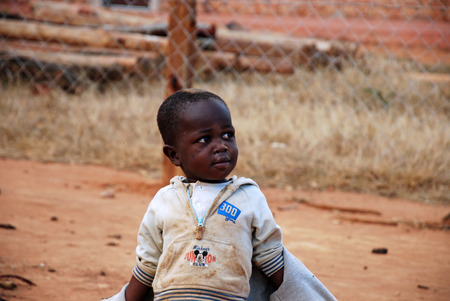 misery: August 2014-Tanzania-Afriva-African children in the Franciscan Mission of the Village of Pomerini hit by the AIDS virus. Between a present of misery, poverty and disease, and a future of hope in their eyes.