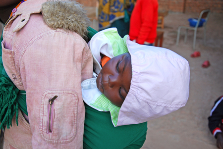 August 2014 - Village of Pomerini - Tanzania - Africa - An African woman with her child received into the Franciscan Mission of Pomerini for Humanitarian Aid for Aids