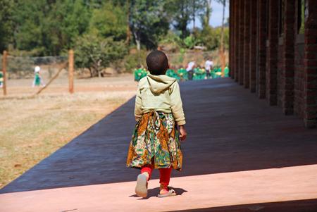 A little girl Guarga play of kindergarten children of the Village of Pomerini-Tanzania-Africa photo