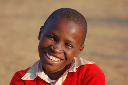 August 2014-Tanzania-Africa-The smile of hope on the faces of African children of the Village of Pomerini affected by the AIDS virus. A smile for a possible future.