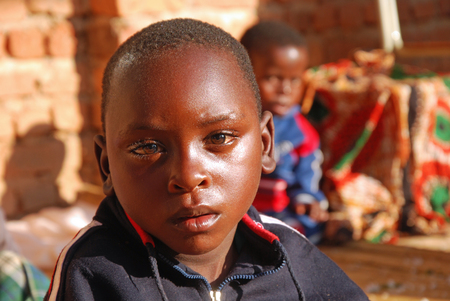 August 2014-Village of Pomerini-Tanzania-Africa-African children of the Franciscan Mission of the Village of Pomerini, a country plagued by the virus of HIV-AIDS, malaria and tuberculosis and poverty and misery
