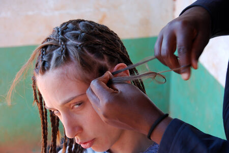 extravagance: African style - A girl with braids - Tanzania - Africa