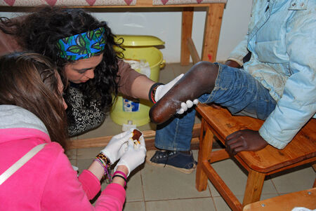 prosthetics: 20.08.2014 - Village Pomerini - Tanzania Africa - Medical intervention of volunteer nurses to a mutilated boy in the leg, in the infirmary of the Franciscan Mission in the Village of Pomerini Editorial