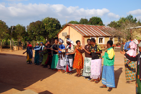 catholic mass: August 4, 2014-Africa-Tanzania-Village Pomerini (Iringa) -The preparation of the dances for the Sunday Catholic Mass - In the courtyard in front of the Church of the Franciscan Mission, some inhabitants exercising repeating the steps and movements typical Editorial