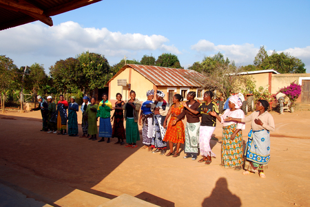 franciscan: August 4, 2014-Africa-Tanzania-Village Pomerini (Iringa) -The preparation of the dances for the Sunday Catholic Mass - In the courtyard in front of the Church of the Franciscan Mission, some inhabitants exercising repeating the steps and movements typical Editorial