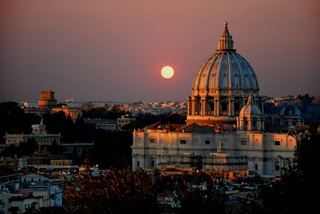 st  peter's basilica pope: The St. Peters Basilica at sunset - A view of St. Peters Basilica at sunset taken from the Janiculum. Rome - Italy