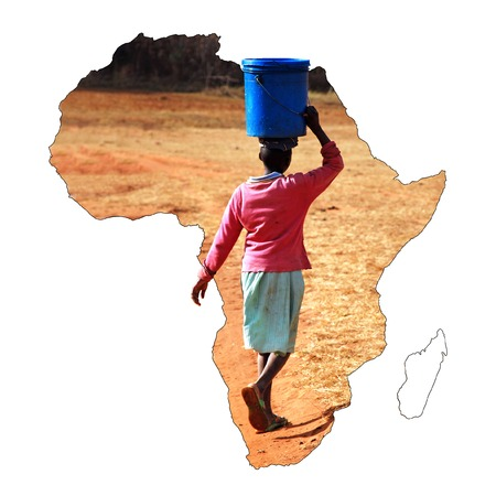 african solidarity: A young African girl carrying a bucket of water on her head - Pomerini - Tanzania - Africa