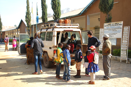 August 28, 2014-Iringa-Tanzania-Africa-A vehicle load of unidentified people that are transported by the volunteers of the NGO Smile to Africa to hospital in the city of Iringa to the monthly monitoring of HIV