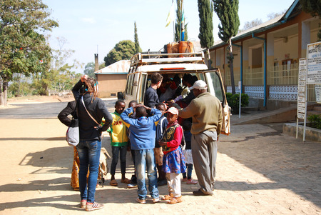 August 28, 2014-Iringa-Tanzania-Africa-A vehicle load of unidentified people that are transported by the volunteers of the NGO