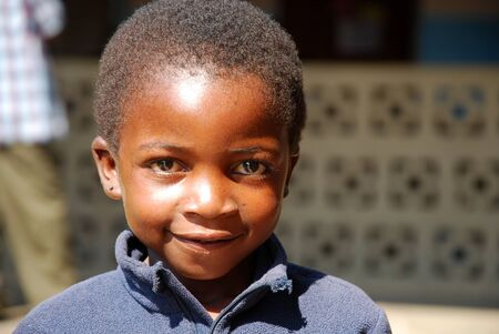 August 29, 2014, Ipamba Hospital of Iringa - Tanzania - Africa - An unidentified African child waiting to be visited by doctors of Ipamba Hospital, unfortunately many of these children are affected by the virus HIV, tuberculosis or malaria and they are fo