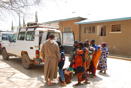 friar: August 25, 2014, Ipamba Hospital of Iringa -Tanzania -Africa -An unidentified Franciscan Friar leads an unidentified group of people to the village of Pomerini (60 km of dirt road) after medical checks carried out at the hospital Editorial