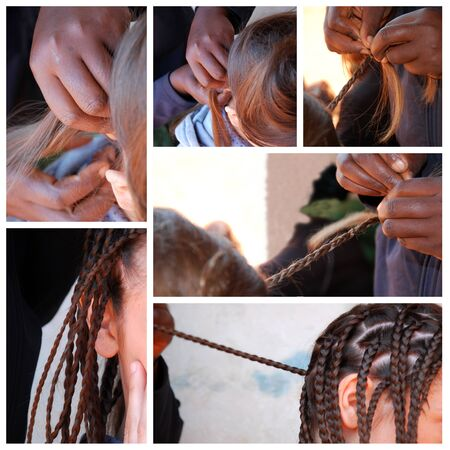 rite: African hairstyle - A white tourist undergoing the rite of African braids by a hairdresser