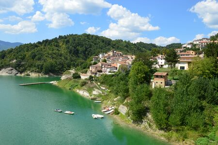 small country town: The country of Fiumata on Lake Salto in Abruzzo - Italy - A view of the small town of Fiumata leaning on Lake Salto in Abruzzo