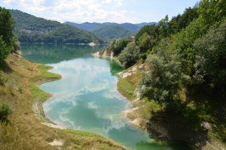 unspoilt: View of the Lake of Salto in Abruzzo, Italy - View the coast of Lake Salto in unspoilt nature