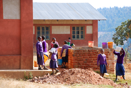 redemption: August 5, 2014, Village of Pomerini, Tanzania, Africa - The unidentified students of the Middle School of Pomerini play in the schoolyard during a break between the lessons, many of them can studied thanks to international aid