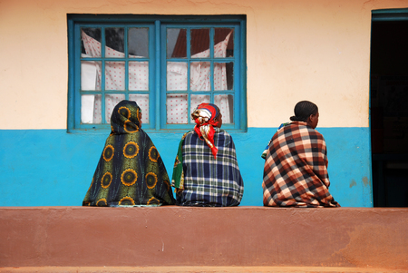 August 18, 2014, Village of Pomerini, Tanzania, Africa - Three unidentified African women waiting to be visited by the doctors of the medical dispensary of the village of Pomerini in Tanzania where diseases such as tuberculosis, AIDS and malaria are still