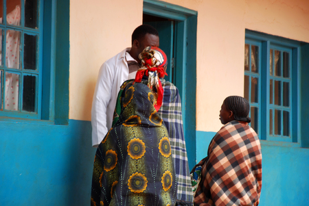 dispensary: August 18, 2014, Village of Pomerini, Tanzania, Africa - Three unidentified African women waiting to be visited by the doctors of the medical dispensary of the village of Pomerini in Tanzania where diseases such as tuberculosis, AIDS and malaria are still
