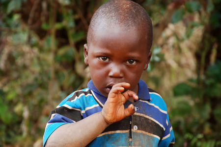humane: August 7, 2014, Mountain Kilolo, Tanzania, Africa - The intense look of an unidentified African child in the mountainous area of Kilolo in Tanzania, where people still live without water, without electricity, in humane conditions appalling