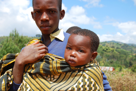 african solidarity: August 8, 2014, Mountain Kilolo, Kilolo, Tanzania, Africa - The intense gaze of two unidentified African children who live on the mountain of Kilolo four hours away on foot from the first motorized means of transport