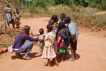 August 8, 2014, Mountain of Kilolo-Kilolo-Tanzania-Africa-An unidentified doctor while visiting a group of unidentified African children in the area of Kilolo where medical care come only through volunteering of international NGOs Redactioneel