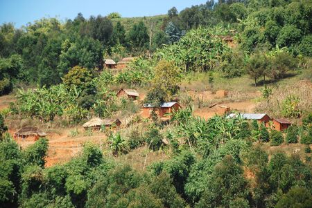 penury: Houses scattered on the mountain of Kilolo, Tanzania, Africa - The poor dwellings of the population of mountain Kilolo in Tanzania Stock Photo