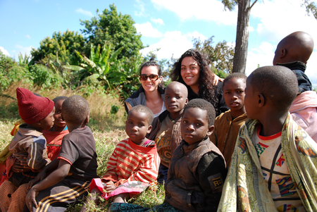 August 8, 2014, Mountain of Kilolo, Kilolo, Tanzania, Africa-A group of unidentified African children on the Mount of Kilolo gathered around the white volunteers of the international non-profit organization that brought food, medicines and clothes Editorial