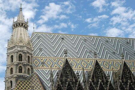 saint stephen cathedral: The artistic roof of the Basilica of Saint Stephen in Vienna in Austria - An example of religious architecture in Vienna Austria