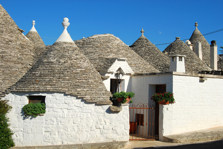trulli: A view of the city of Alberobello and its trulli in Apulia - Italy Stock Photo